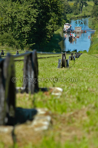 Cable pulling boat cradle. Ostroda - Elblag Canal: Overland transportation of boats on rail cars at the Elblag Canal (Polish: Kanal Elblaskie, German: Oberlaendischer Kanal), Masuria, Poland, Europe. No releases available. ---Info: A system of rail-mounted cable trolleys on skipways and traditional locks are connecting the various sections of the Elblag Canal. A 100 metre difference in water levels is overcome during a length of 80 km between Ostroda and Elblag. The rail lift devices are mechanically driven by water power. --- HISTORY: The canal was designed in 1825-1844 by Georg Steenke, carrying out the commission given by the king of Prussia. Construction began in 1844. As the route was not important enough to justify building expensive, traditional locks between lakes, an ingenious system of tracks was employed instead, though the canal includes a few locks as well. Built originally under the name Oberländischer Kanal (Overland Canal) and situated in the Kingdom of Prussia, it was opened in 1860. Since 1945 the canal has been located in Poland. After wartime damage was repaired, it was restored to operation in 1948. Today it is used mainly for recreational purposes. It is considered one of the most significant monuments related to the history of technology on the territory of modern Poland..