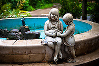 An empty fountain with a broken statue of girls holding a rabbit at the Havana Zoo, Havana, Cuba, 12 February 2011. The largest and the oldest zoo in Cuba (founded in 1939) is located in a centric neighborhood of the capital. Since the 1990s Cuba struggles with chronic economic crisis and therefore the strong marks of rundown and lack of sources are evident within the whole zoological garden. A lot of cages are empty and out of use for long time, the remaining animals are captured in poorly maintained pits. Concrete enclosures have no vegetation, all facilities are unkept. The food supply is often inadequate and visitors throw junkfood to the animals because there are no zookeepers around.