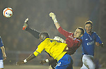 Cowdenbeath v St Johnstone ..17.12.12      Scottish Cup.Gregory Tade battles with Thomas Flynn.Picture by Graeme Hart..Copyright Perthshire Picture Agency.Tel: 01738 623350  Mobile: 07990 594431