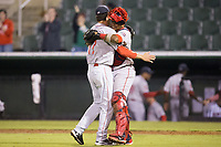 Greenville Drive relief pitcher Hunter Smith (17) gets a hug from catcher Roldani Baldwin (16) after closing out the win over the Kannapolis Intimidators in Game Two of the 2017 South Atlantic League Championship at Kannapolis Intimidators Stadium on September 13, 2017 in Kannapolis, North Carolina.  The Drive defeated the Intimidators 2-0.  (Brian Westerholt/Four Seam Images)