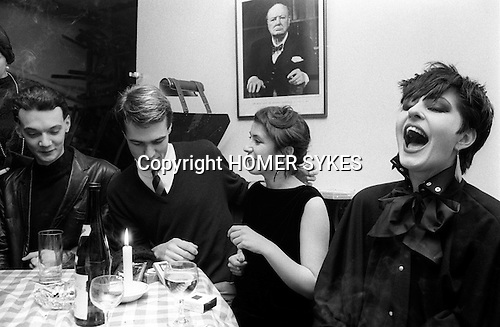 Covent Garden, London. 1980 <br /> By 1980 the Blitz Club had relocated from Soho, to a down-at-heal wine bar in Great Queen Street, which was decked out in Second World War posters and a photograph of Prime Minister, Winston Churchill.<br /> Girl laughing is Helen Robinson of PX Fashion<br /> ( thanks to Rusty Egan.)