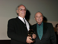 Montreal, 1999-09-06. At the closing ceremonies of the 1999 World Film Festival  tonight in Montreal (Quebec, Canada ),  Spanish film maker Carlos Saura (left) received the prize for best artistic contribution for his movie `` Goya en Burdeos ``. <br /> Photo :  (c)  Pierre Roussel, 1999<br /> KEYWORDS :  Awards, World Film Festival, Montreal, Quebec, Canada, Carlos Saura