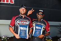 Sep 13, 2013; Charlotte, NC, USA; NHRA top fuel dragster driver Khalid Albalooshi (right) with teammate Shawn Langdon during qualifying for the Carolina Nationals at zMax Dragway. Mandatory Credit: Mark J. Rebilas-