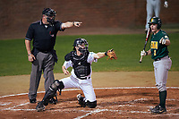 Umpire Ray Parrish and Stetson Hatters catcher Austin Hale (18) point to Phil Madonna (3) saying he swung as he points to the first base umpire for a check during a game against the Siena Saints on February 23, 2016 at Melching Field at Conrad Park in DeLand, Florida.  Stetson defeated Siena 5-3.  (Mike Janes/Four Seam Images)