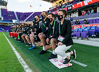 ORLANDO, FL - FEBRUARY 21: Bev Priestman ofCanada kneels before her national anthem during a game between Canada and Argentina at Exploria Stadium on February 21, 2021 in Orlando, Florida.