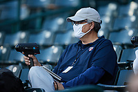 Minnesota Twins scout John Manuel uses a radar gun during the minor league baseball game between the Hickory Crawdads and the Greensboro Grasshoppers at First National Bank Field on May 6, 2021 in Greensboro, North Carolina. (Brian Westerholt/Four Seam Images)