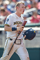 Michigan Wolverines first baseman Jimmy Kerr (15) celebrates after scoring during Game 11 of the NCAA College World Series against the Texas Tech Red Raiders on June 21, 2019 at TD Ameritrade Park in Omaha, Nebraska. Michigan defeated Texas Tech 15-3 and is headed to the CWS Finals. (Andrew Woolley/Four Seam Images)