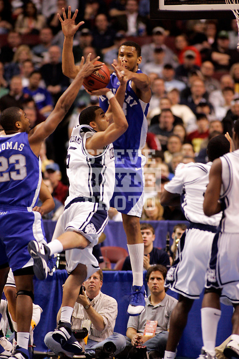 Connecticut guard Marcus Williams (5) attempts a shot with Kentucky forwards Randolph Morris (33) and Sheray Thomas (23) defending.  Connecticut defeated Kentucky 87-83 in the second round of the NCAA Tournament  at the Wachovia Center in Philadelphia, Pennsylvania on March 19, 2006.