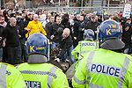 © Joel Goodman - 07973 332324 - all rights reserved . 03/04/2010 . Dudley , UK . EDL protesters face off with police dog handlers . The English Defence League ( EDL ) hold a demonstration in Dudley , opposed by Unite Against Fascism ( UAF ) . Photo credit : Joel Goodman