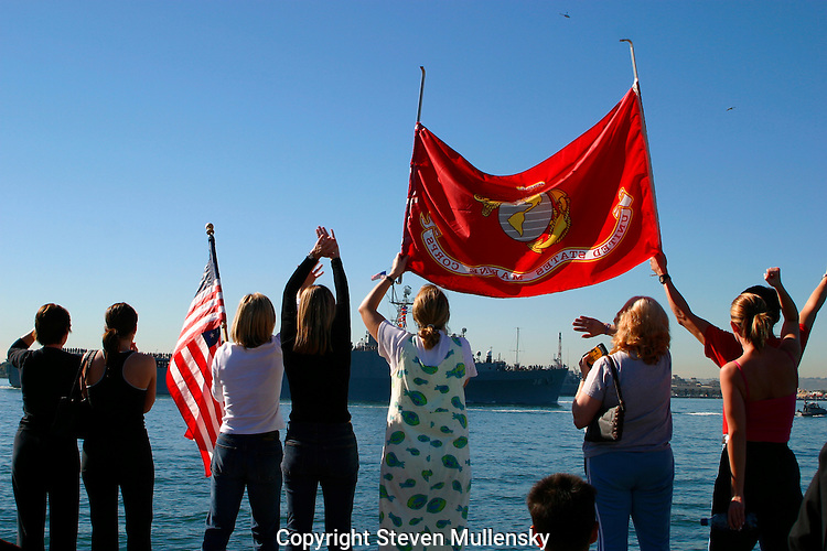 Relatives and friends wave goodbye to their loved ones aboard the USS Anchorage as it departs San Diego Bay for duty in the Persian Gulf.