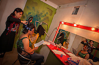 Ali Saleem review his script as a make up artist takes care of him to look like a woman's hairstyle.