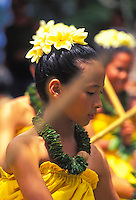 Children dancing hula with puili (slit bamboo)