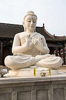 Yangzhou, Jiangsu, China.  Statue of the Buddha in Daming Temple Grounds.  The Buddha is demonstrating the Dharmachakra mudra, or gesture.