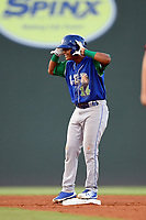 Third baseman Carlos Diaz (14) of the Lexington Legends gestures to teammates after hitting a double during a game against the Greenville Drive on Saturday, September 1, 2018, at Fluor Field at the West End in Greenville, South Carolina. Greenville won, 9-6. (Tom Priddy/Four Seam Images)