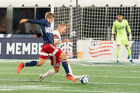 FOXBOROUGH, MA - OCTOBER 16: Derek Waldeck #18 of North Texas SC tackles Justin Rennicks #12 of New England Revolution II during a game between North Texas SC and New England Revolution II at Gillette Stadium on October 16, 2020 in Foxborough, Massachusetts.