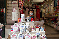 LISBON, PORTUGAL - MAY 18 :  A souvenir store employee poses for a portrait at her workplace in Lisbon, on May 18, 2020. <br /> Restaurants, museums and coffee shops reopen at reduced capacity, while Lisbon eases lockdown coronavirus disease (COVID-19) outbreak.<br /> (Photo by Luis Boza/VIEWpress via Getty Images)