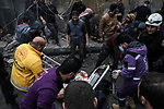 Rescue workers carry away a victim at the scene of an explosion in the town of Azaz in the rebel-controlled northern countryside of Syria's Aleppo province, on January 31, 2021. A car bomb killed at least six people, including three civilians, in the Turkish-held northern town of Azaz in war-torn Syria today, a war monitor said. The attack, which occurred near a cultural centre, also wounded more than 22 others, the Britain-based Syrian Observatory for Human Rights said. Photo by Nayef ALaboud