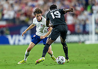 NASHVILLE, TN - SEPTEMBER 5: Brenden Aaronson #11 of the United States defends Alphonso Davies #19 of Canada during a game between Canada and USMNT at Nissan Stadium on September 5, 2021 in Nashville, Tennessee.