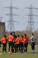 Young football players prepare for kick-off at Hackney Marshes in front of electricity pylons - 02/03/08 - MANDATORY CREDIT: Gavin Ellis/TGSPHOTO - Self billing applies where appropriate - Tel: 0845 094 6026