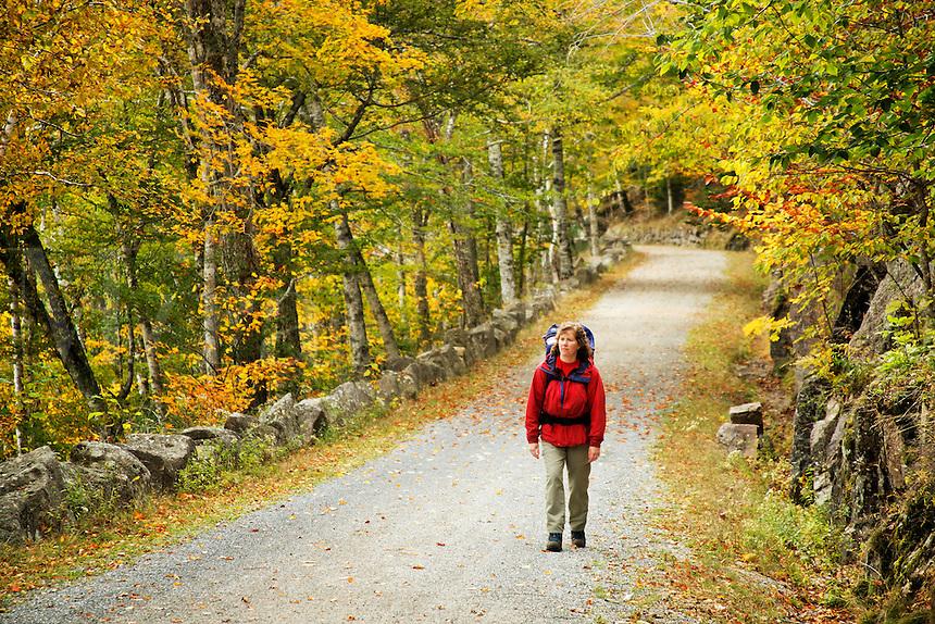 Woman walking carriage road, Acadia National Park, Hancock County, Maine, US
