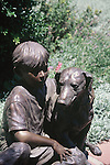 BOY AND DOG SCULPTURE