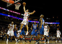 Charlotte Bobcats guard Matt Carroll (13) shoots the ball over the Orlando Magicduring an NBA basketball game  at Time Warner Cable Arena in Charlotte, NC.