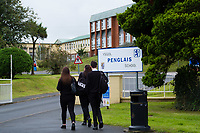 "COPY BY TOM BEDFORD<br /> Pictured: Pupils arrive in the morning at Ysgol Penglais School in Aberystwyth, Wales, UK<br /> Re: More than 400 pupils at a comprehensive school in Aberystwyth were given detention on their first day back for breaking school uniform rules.<br /> The uniform was changed at Ysgol Penglais over the summer, following a consultation.<br /> But a number of parents have complained to the school and some 250 have signed a petition saying the punished pupils were ""treated unfairly"".<br /> Ceredigion council said a large number of pupils were kept in at break times.<br /> The new uniform was brought in for the start of the new academic year, with the old navy blue pullover and white polo shirt replaced by a grey v-neck jumper, white shirt and a tie. Sixth formers have a similar outfit.<br /> It is compulsory for all pupils in years 7 and 12 to wear the new uniform, with other students being given the rest of the year to buy it.<br /> This was outlined in correspondence sent to all parents over the summer months, which also stipulated what trousers, skirts and shoes would be deemed acceptable.<br /> But the petition said the new rules were not clear enough and that the pupils should not have been punished for their parents' mistakes.<br /> It also said a warning should have been given before the detention."