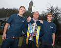 Former Falkirk player and current youth team coach Steve Fulton and sons Dale and Jay (right), who both currently play for Falkirk, get their hands on the Scottish Cup ahead of their game against Forfar.