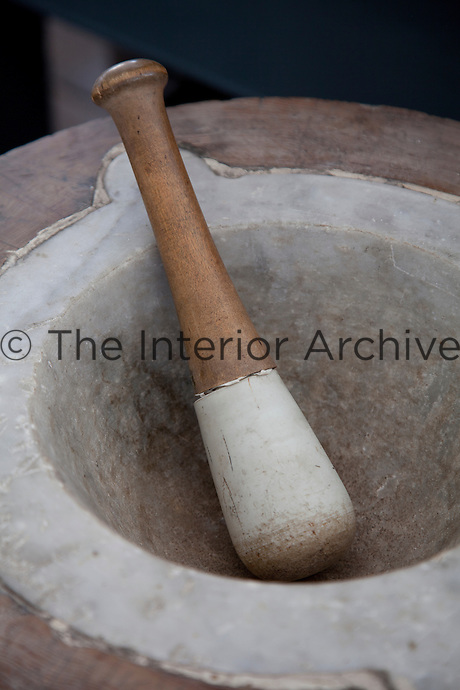 A well used marble pestle and mortar in the kitchen