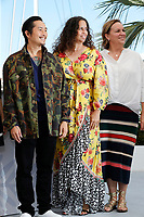 """CANNES, FRANCE - JULY 13: (L to R) Director Justin Chon, Producer Poppy Hanks and Kim Roth attend the """"Blue Bayou"""" photocall during the 74th annual Cannes Film Festival on July 13, 2021 in Cannes, France. <br /> CAP/GOL<br /> ©GOL/Capital Pictures"""