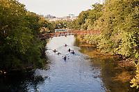Canoes and kayaks navigate Barton Creek at Zilker Park, Austin, Texas