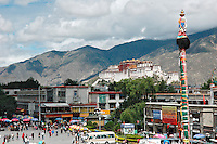 The Potala palace as seen from the roof of the Jokhang temple, Lhasa, Tibet. The number of tourists allowed to enter the palace is strictly regulated to 2,300 each day and the entrance fee for tourists has increased to 300 RMB, a large amount in China. .27 Jul 2006