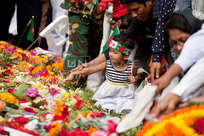 Bangladeshi people pay homage at the Dhaka Central Shaheed Minar, or Martyr's Monuments on International Mother Language Day in Dhaka, Bangladesh, Saterday, Feb. 21, 2015.