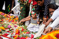 Bangladeshi people pay homage at the Dhaka Central Shaheed Minar, or Martyr's Monuments on International Mother Language Day in Dhaka, Bangladesh, Saterday, Feb. 21, 2015.
