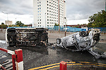 © Joel Goodman - 07973 332324 . 09/08/2011 . Salford , UK . Overturned and burned out vehicles at Salford Precinct  as disorder spreads to Manchester during a 4th night of rioting and looting , following a protest against the police shooting of Mark Duggan in Tottenham . Photo credit : Joel Goodman