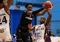 Tony Hicks of Surrey Scorchers battles against Rahmon Fletcher of Newcastle Eagles during the BBL Championship match between Surrey Scorchers and Newcastle Eagles at Surrey Sports Park, Guildford, England on 20 March 2021. Photo by Liam McAvoy.