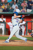 Chris Carrier (13) of the South Bend Cubs follows through on his swing against the Lansing Lugnuts at Cooley Law School Stadium on June 15, 2018 in Lansing, Michigan. The Lugnuts defeated the Cubs 6-4.  (Brian Westerholt/Four Seam Images)