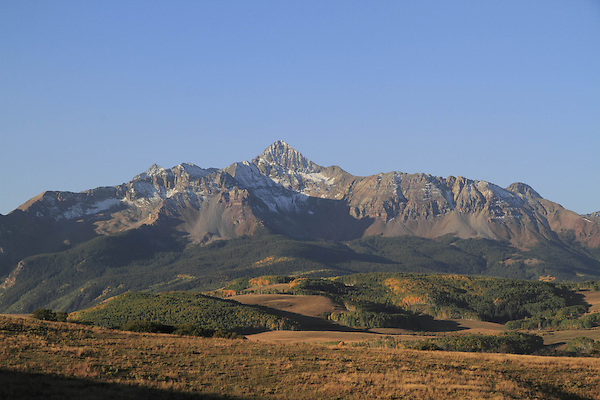 Wilson Peak with evergreen trees in the morning, San Juan Mountains near Telluride, Colorado, USA.