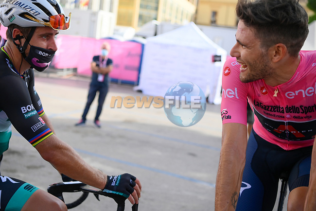 Peter Sagan (SVK) Bora-Hansgrohe chats with race leader Filippo Ganna (ITA) Ineos Grenadiers at the end of Stage 2 of the 103rd edition of the Giro d'Italia 2020 running 149km from Alcamo to Agrigento, Sicily, Italy. 4th October 2020.  <br /> Picture: LaPresse/Marco Alpozzi | Cyclefile<br /> <br /> All photos usage must carry mandatory copyright credit (© Cyclefile | LaPresse/Marco Alpozzi)