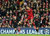 Liverpool's Virgil van Dijk heads clear under pressure from Atletico Madrid's Joao Felix <br /> <br /> Photographer Rich Linley/CameraSport<br /> <br /> UEFA Champions League Round of 16 Second Leg - Liverpool v Atletico Madrid - Wednesday 11th March 2020 - Anfield - Liverpool<br />  <br /> World Copyright © 2020 CameraSport. All rights reserved. 43 Linden Ave. Countesthorpe. Leicester. England. LE8 5PG - Tel: +44 (0) 116 277 4147 - admin@camerasport.com - www.camerasport.com