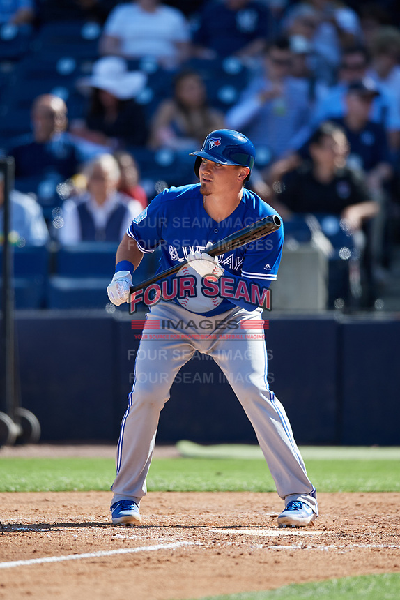Toronto Blue Jays catcher Reese McGuire (10) squares around to bunt during a Grapefruit League Spring Training game against the New York Yankees on February 25, 2019 at George M. Steinbrenner Field in Tampa, Florida.  Yankees defeated the Blue Jays 3-0.  (Mike Janes/Four Seam Images)