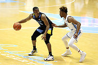 CHAPEL HILL, NC - FEBRUARY 24: Koby McEwen #25 of Marquette is guarded by Anthony Harris #0 of North Carolina during a game between Marquette and North Carolina at Dean E. Smith Center on February 24, 2021 in Chapel Hill, North Carolina.