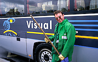 A Paris street cleaner at a Bus stop, Paris France