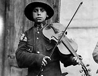 A Christmas street fiddler, Belgrade,  Serbia (Yugoslavia), December 1918.  American Red Cross. (War Dept.)<br /> Exact Date Shot Unknown<br /> NARA FILE #:  165-WW-489B-10<br /> WAR & CONFLICT BOOK #:  676