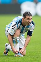 Lionel Messi of Argentina ties his laces