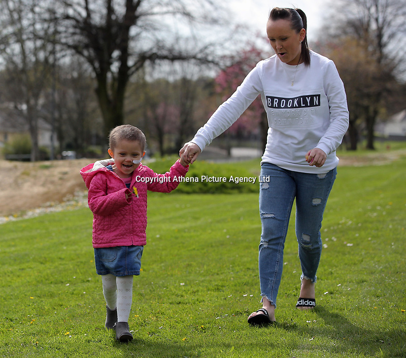 """COPY BY TOM BEDFORD<br /> Pictured L-R: Mia Chambers running with her mum Kirsty<br /> Re: One of Britain's poorest towns is raising £100,000 to send a little girl to America because the lifesaving drugs she needs are not available on the NHS.<br /> Brave Mia Chambers, five, is in remission after having an ovary and kidney removed due to neuroblastoma, a rare and aggressive type of cancer.<br /> Doctors have told her parents Josh and Kirsty there is a 50 per cent chance of the cancer returning without the specialist drugs.<br /> Josh, 28, said: """"That's not a chance we are prepared to take - the odds are too high.<br /> """"We researched it on the internet and found children in the US are beating this terrible illness.<br /> """"Doctors there are willing to treat her but it will cost more money than we have.""""<br /> The couple's plight has touched the hearts of people in their home town of Merthyr Tydfil, South Wales, and money has begun pouring in.         <br /> Mia had chemotherapy on the Rainbow ward at the Noah's Ark Children's Hospital for Wales where nurses nicknamed her the Rainbow Warrior because of her fighting spirit."""
