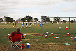 CHAD PILSTER •Hays Daily News<br /> <br /> Parents watch their kids on Tuesday, September 10, 2013, during practice of the third grade Gamblers of the Hays Football Association  at Aubel-Bickle Park in Hays, Kansas.