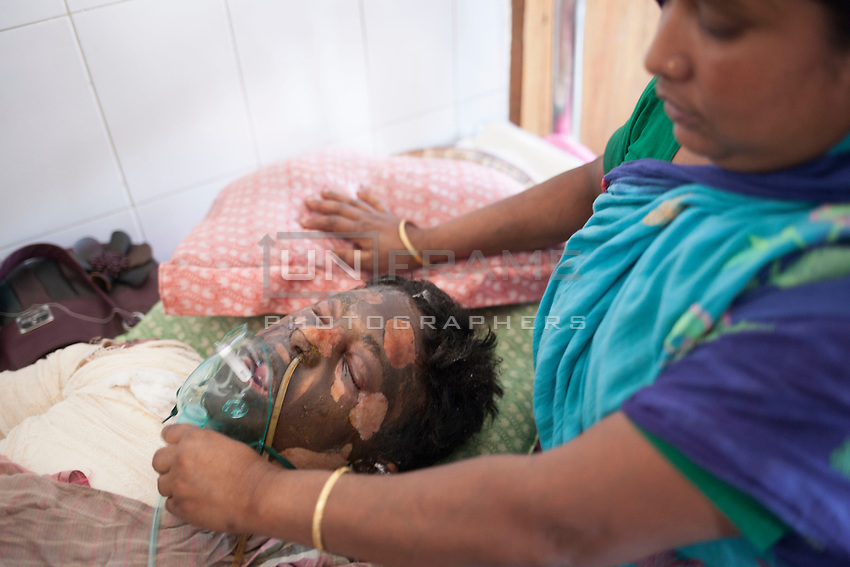Matin Biswas, 25, a victim of the Magura arson attack died at a hospital in Dhaka, Bangladesh, around 4:50pm, March 22, 2015. Ten people, including eight workers, suffered burn injuries in a petrol bomb attack on a sand-laden truck at Moghirdhal on the Magura-Jessore road in Sadar upazila on Saturday night.  As the truck reached Moghirdhal around 8:00pm, miscreants hurled a petrol bomb at the vehicle. Soon after the petrol bomb attack, the truck went up in flames, leaving eight workers and the truck driver and his helper burnt.