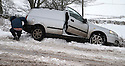 21/01/15<br /> <br /> A car lies in a ditch after sliding of the A515 near Hartington, Derbyshire.<br /> <br /> More than 20 schools in Derbyshire were closed today following overnight snowfall that continued into the morning across the Peak District.<br /> <br /> All Rights Reserved - F Stop Press.  www.fstoppress.com. Tel: +44 (0)1335 300098