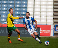 12th September 2020 The John Smiths Stadium, Huddersfield, Yorkshire, England; English Championship Football, Huddersfield Town versus Norwich City;  Harry Toffolo of Huddersfield Town plays the ball forward watched by  Todd Cantwell of Norwich City